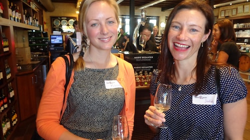 Two friends enjoy wine at wine tour in Perth