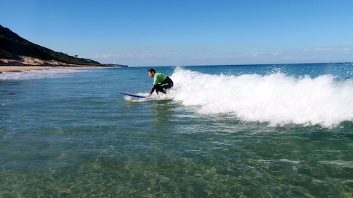 Guy Surfer riding wave to shore on the Great Ocean Road Surf Lesson in Australia