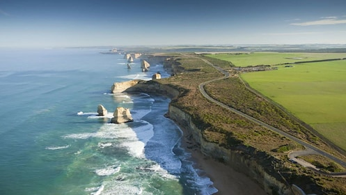 Ariel view of 12 Apostles rock formations and highway in Great Ocean Road