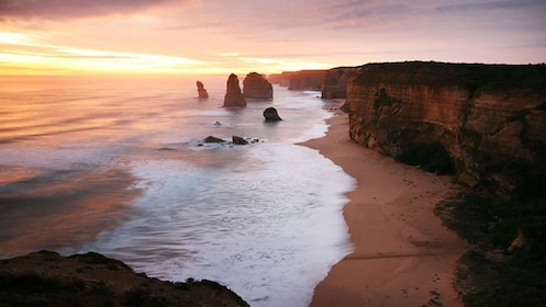 sunset view of 12 Apostles rock formation in Great Ocean Road