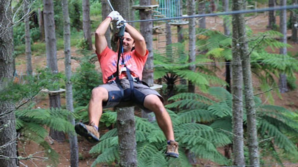 Show item 1 of 5. man use zip line at zip course in Canterbury