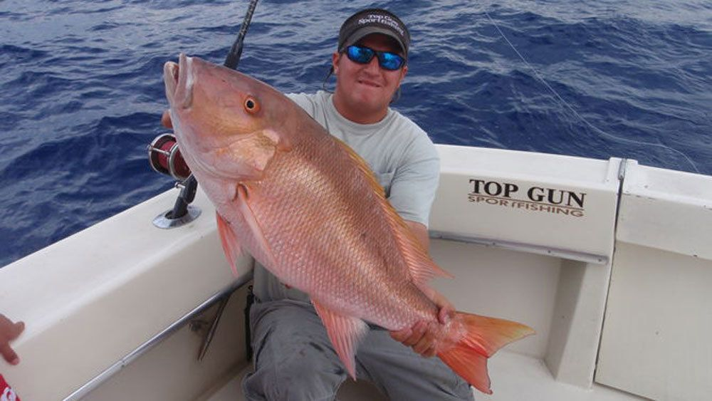 Displaying the catch of the day aboard the Top Gun in Key West