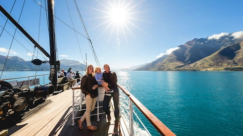 Family on a boat in the water off of Queenstown