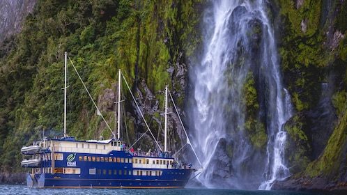 Boat next to a waterfall