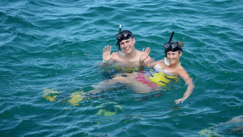 Two snorkelers in the water near Nevis