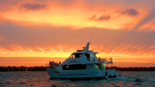 pleasure craft sailing at sunset in Fraser Coast