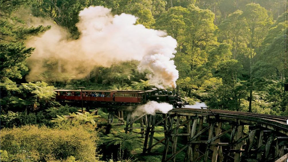 Show item 3 of 4. Puffing Billy train on expansion bridge in Yarra Valley