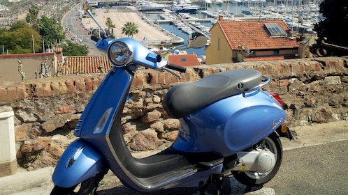 View of a blue Vespa parked in Cannes