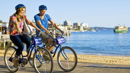 Bicyclist on shore of Sydney.