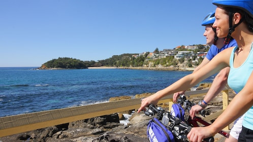 Bicyclist over looking at ocean in Sydney.