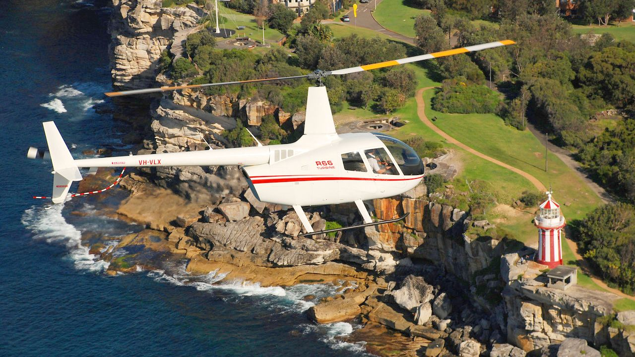 Helicopter flying over the shore line in Australia.