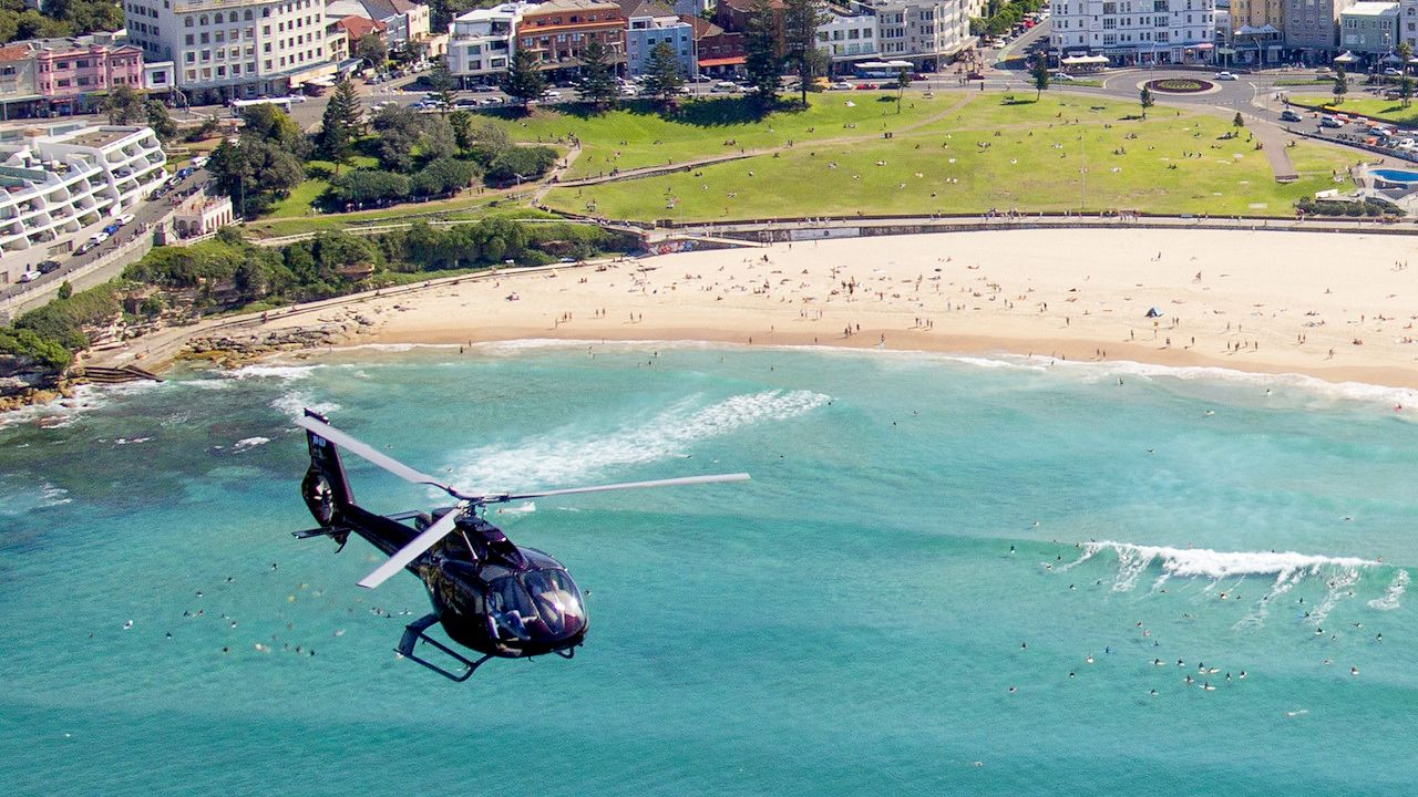 Helicopter flying over the Sydney Harbour for tour in Australia.