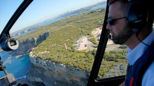 Pilot in flight on Sydney Grand Helicopter tour in Australia.