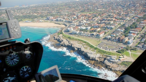Shore line and cityscape of Sydney in the Grand Helicopter tour in Australia.