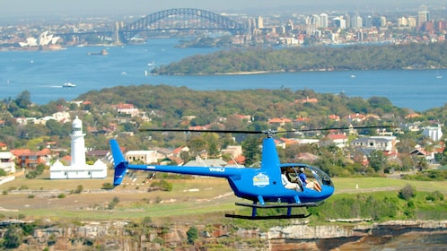 Helicopter over Sydney Bay area in Grand Helicopter tour in Australia.