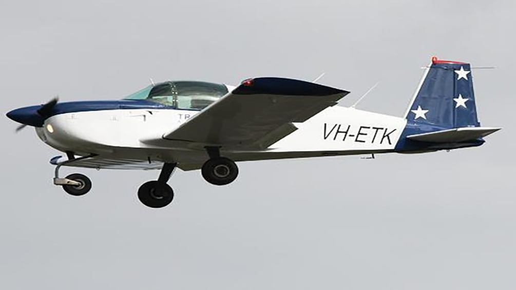 Show item 4 of 4. small aircraft flying in Melbourne