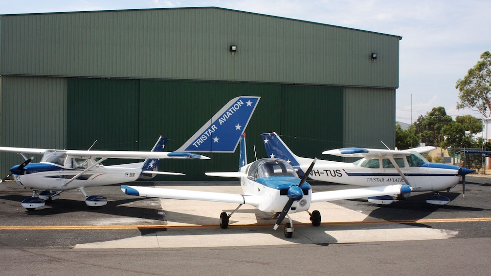 Show item 2 of 4. three small aircraft at aircraft training school in Melbourne