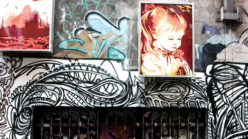 alleyway with framed artwork hanging on the wall in Melbourne
