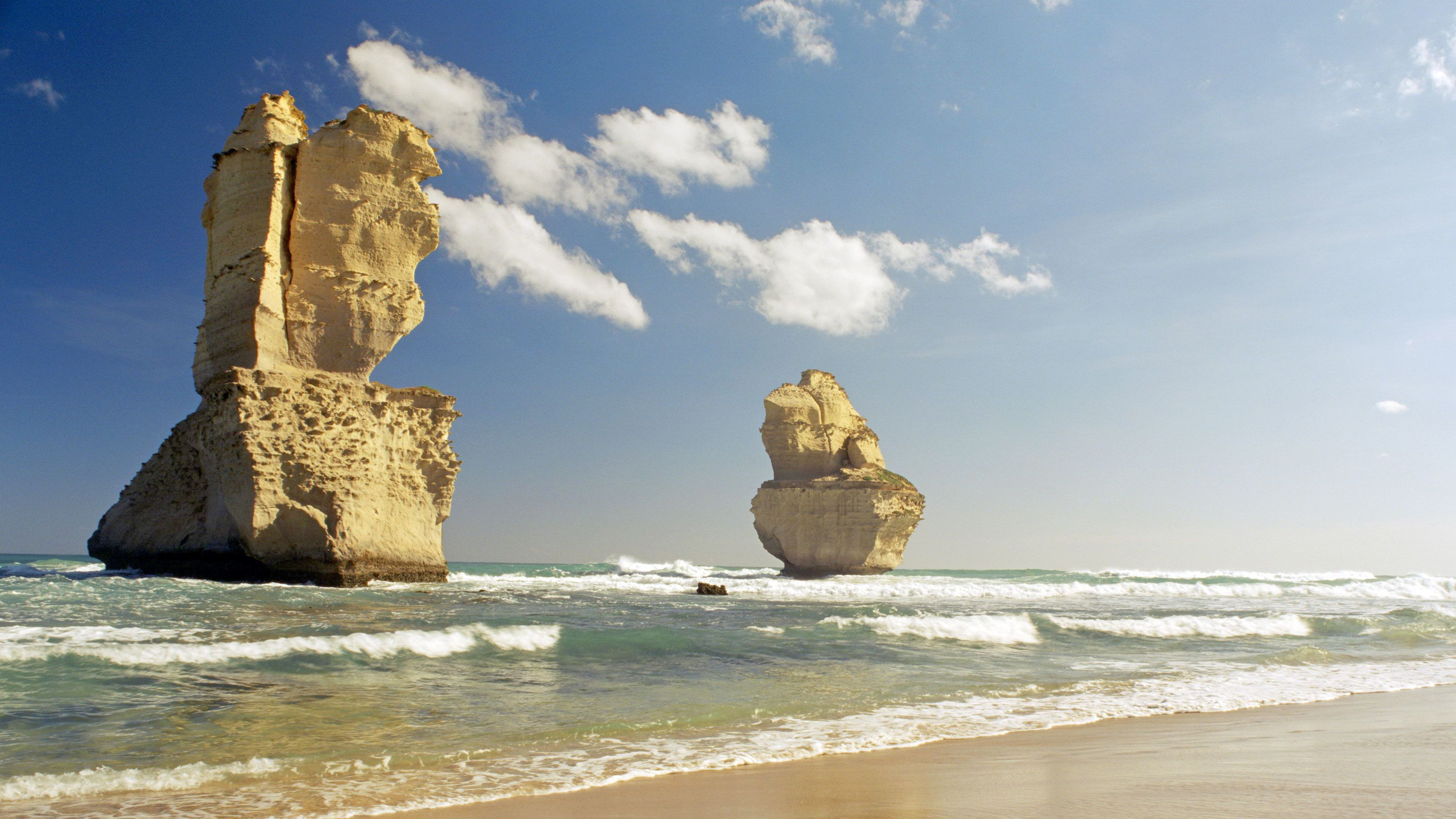 Two of the Twelve Apostles from beach level.