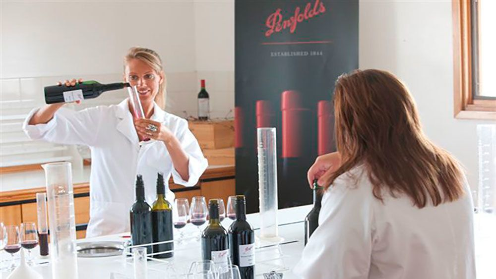 two women pouring wine into beakers in Barossa Valley