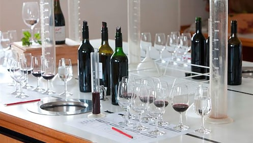 bottles of wine, stem ware and test beakers in Barossa Valley