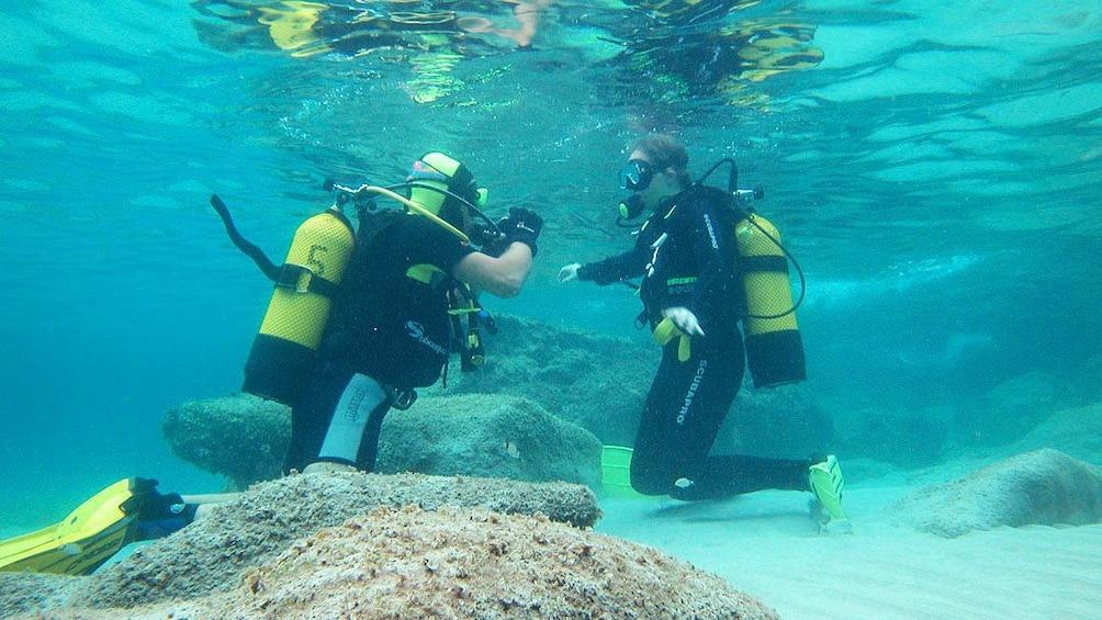 Two people diving in Santa Ponsa