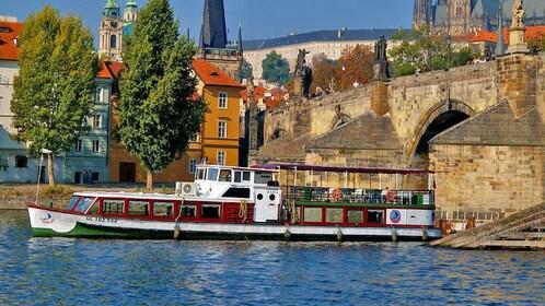 Boat passing under a bridge in the Vltava River in Prague
