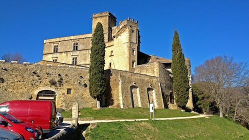 Ancient stone wall and buildings in Lourmarin