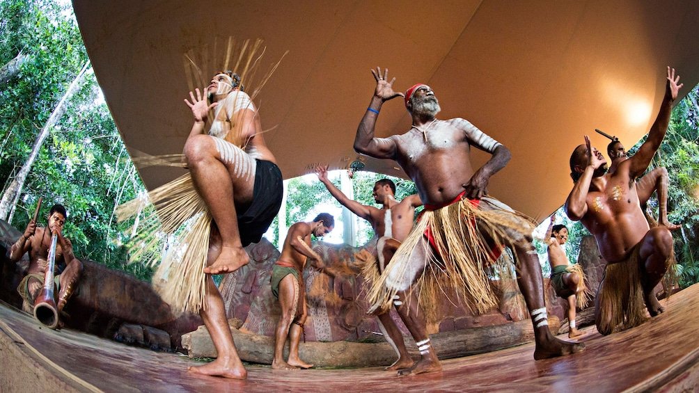 group of aboriginals perform a native dance in Cairns