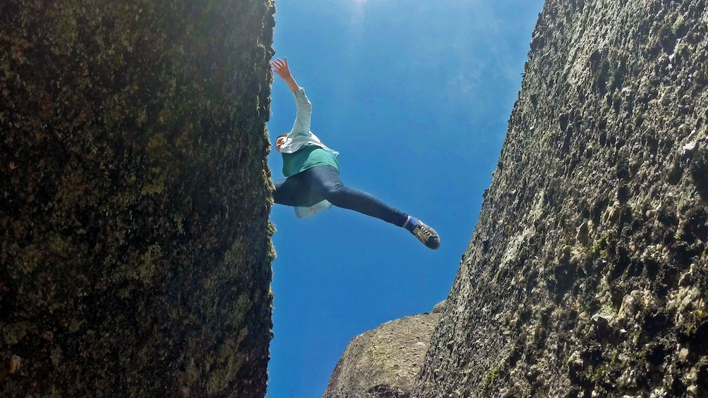 Show item 2 of 7. Woman leaping over narrow ravine in Gerêz National Park