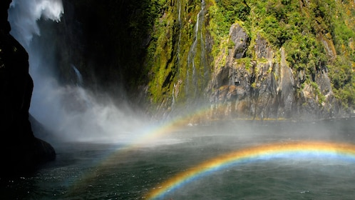 Waterfall and rainbow on Milford Sound Cruise in New Zealand.
