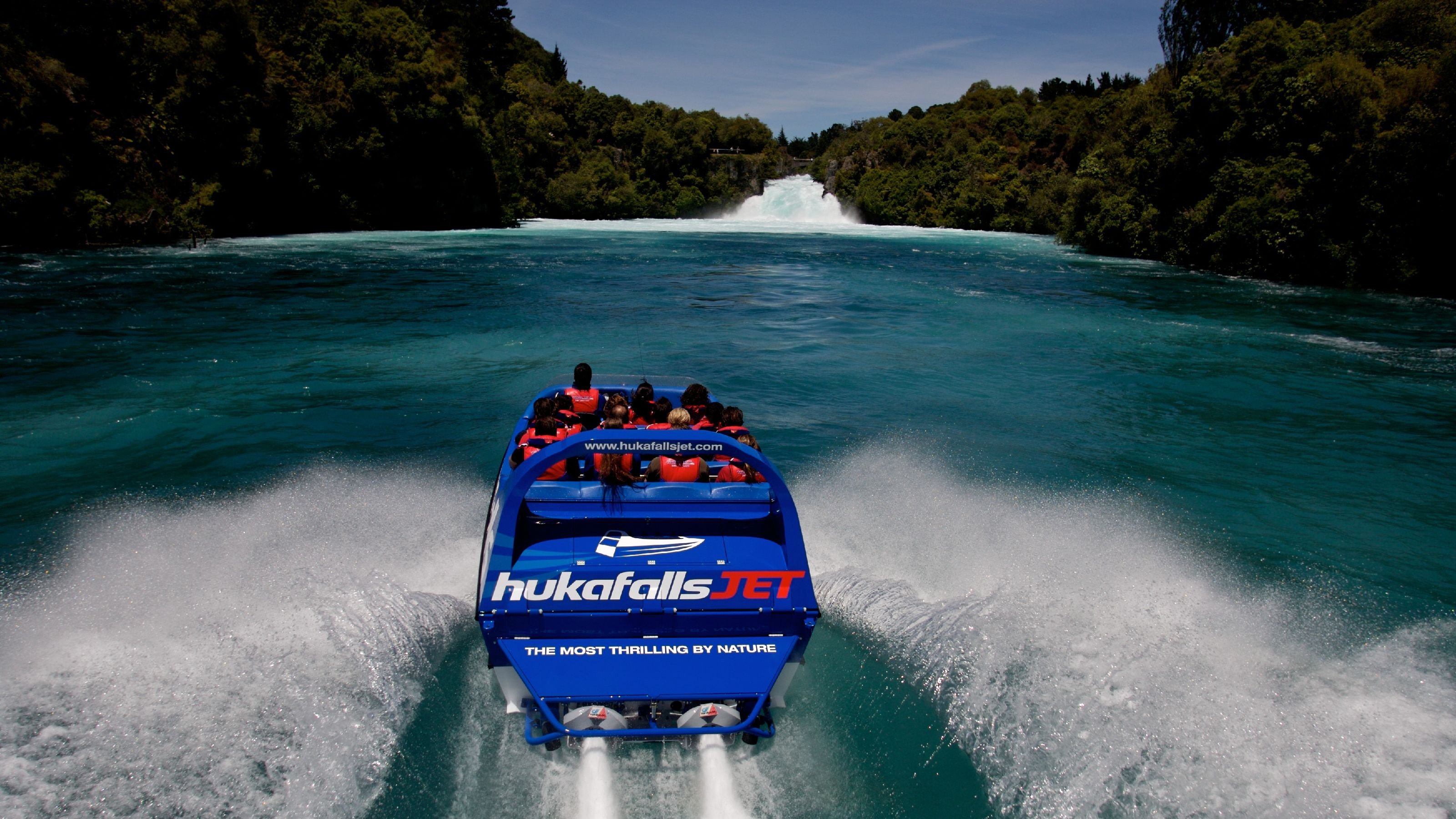 passengers riding in a jet boat in Taupo