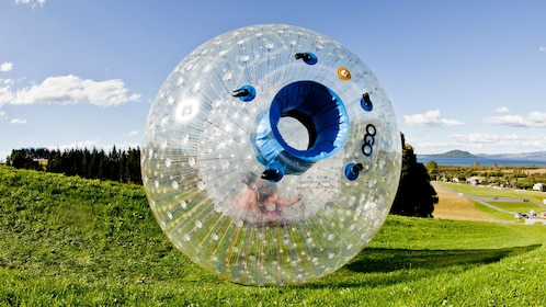 Plastic Zorbing Orb on grassy hills, Rotorua New Zealand.