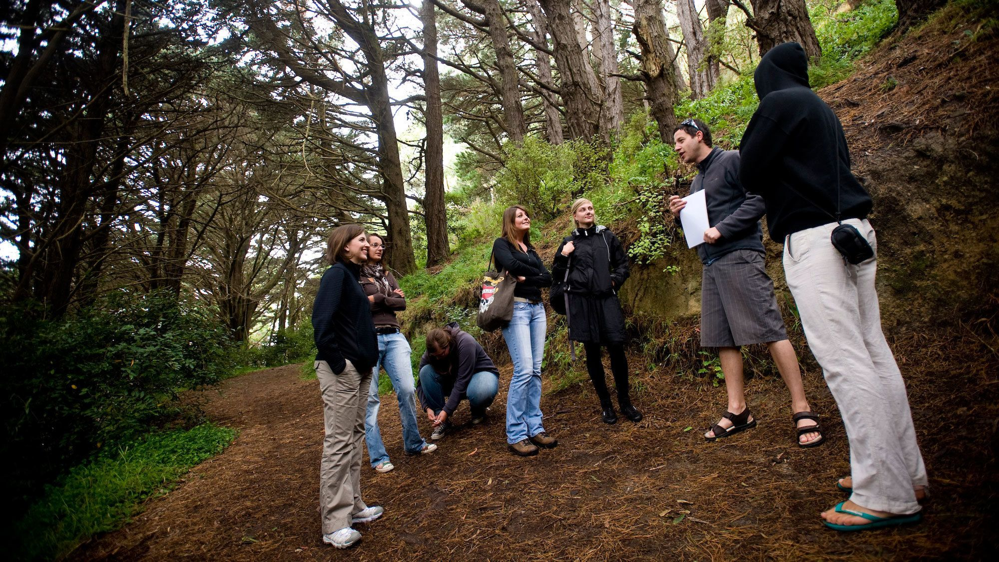 group of people and tour guide describing the trail