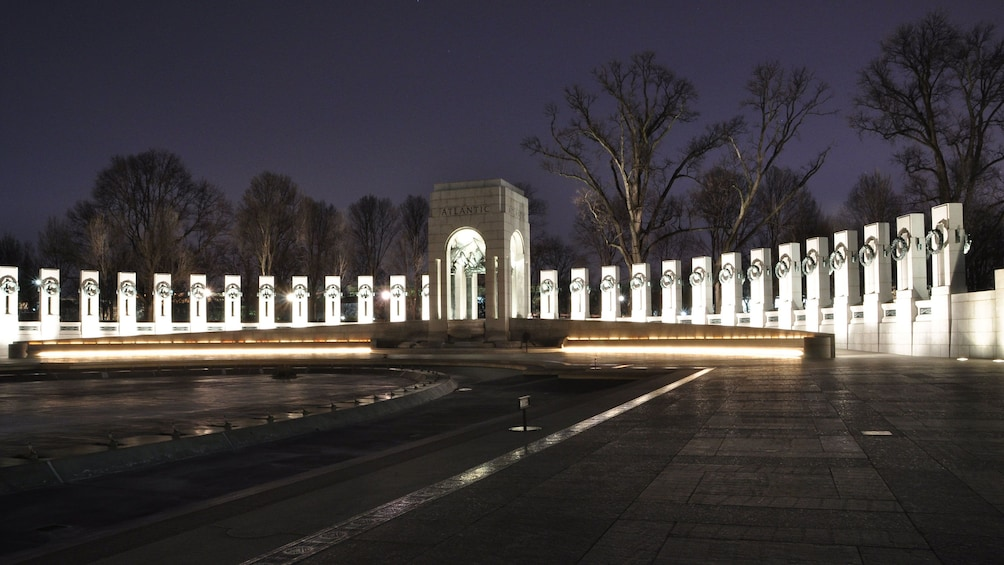 Show item 3 of 8. The national world war two monument in Washington DC at night
