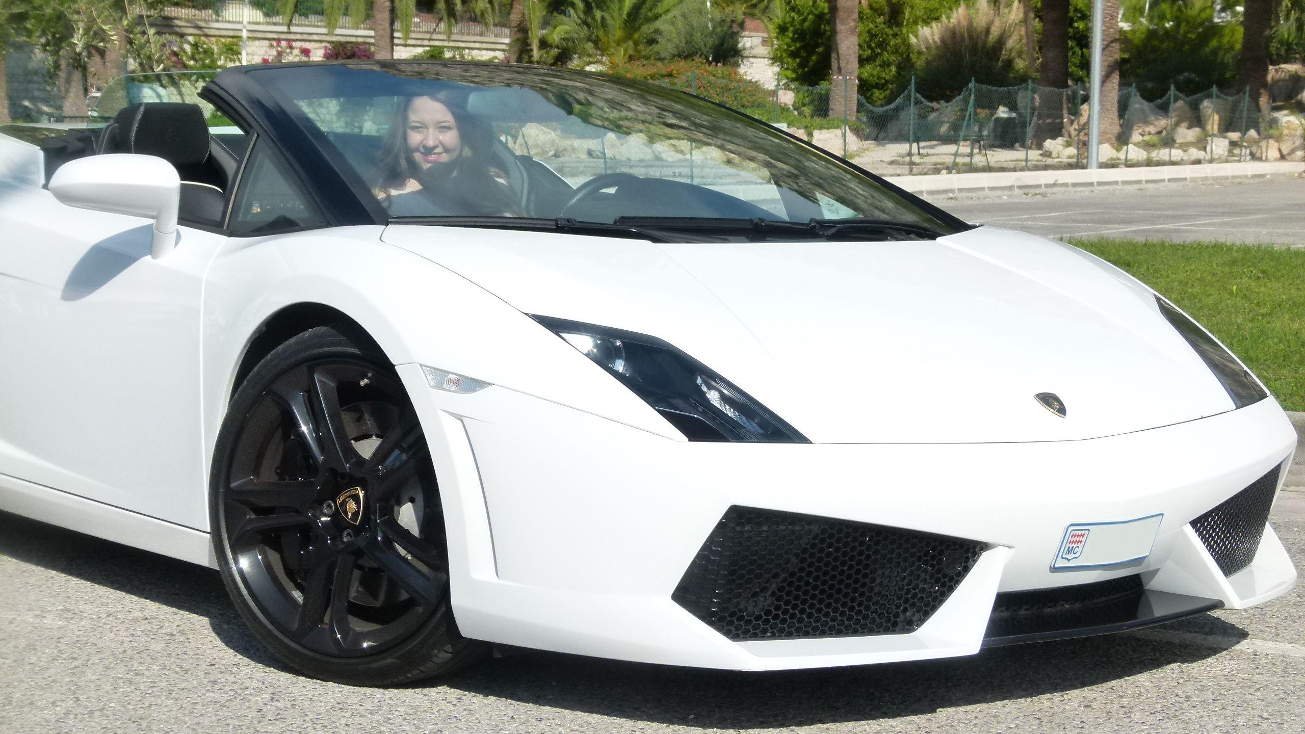 Woman driving a Lamborghini in Monaco