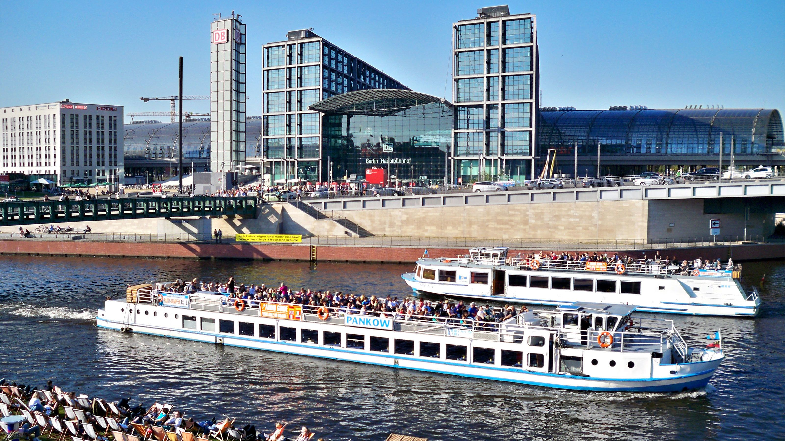Cruise boats sailing down the Spree river in Berlin