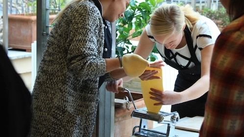 girls using pasta maker