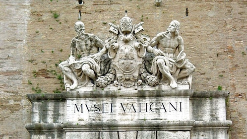 Ancient statue overlooking the Trevi Fountain within the Vatican.