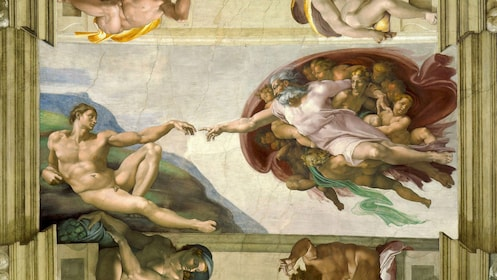 Closeup photo of the Creation of Adam, painted by Michelangelo within the Sistine Chapel.