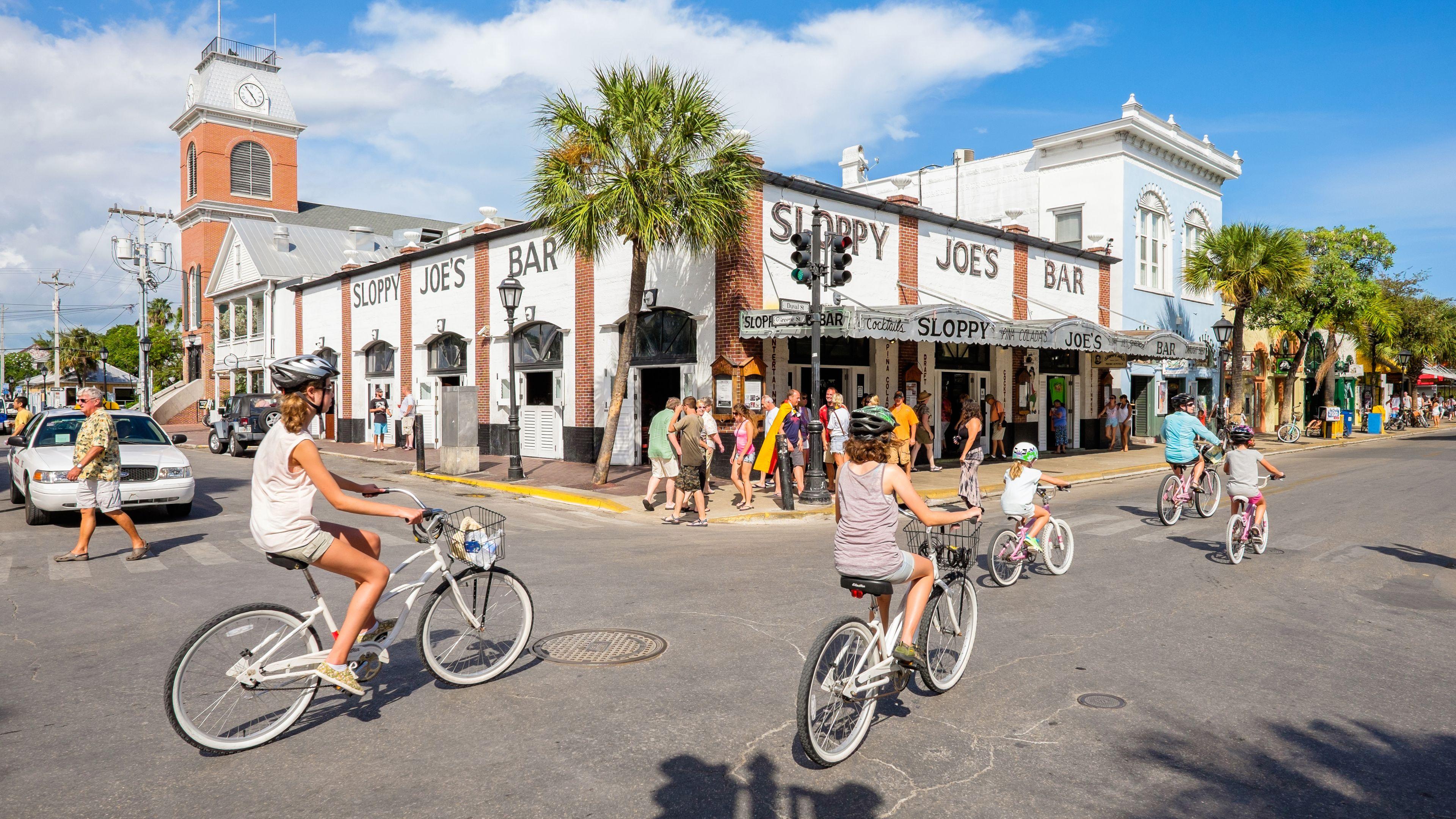 Riding bikes near a bar in Miami