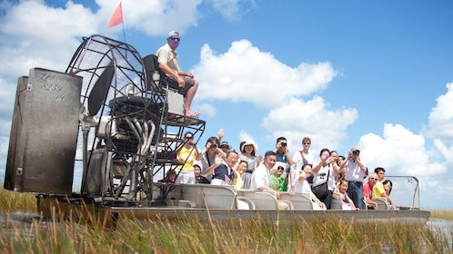 Airboat with passengers in the Everglades