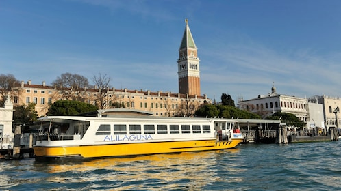 Tour boat on a canal in Venice Italy