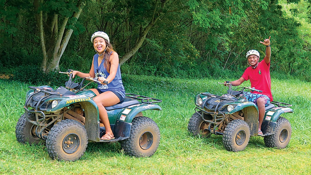Show item 8 of 8. people on atvs in guam