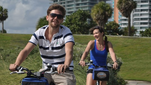 Bicyclists riding down the streets of Miami