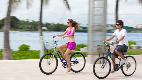 Bicyclists riding alongside the Miami River