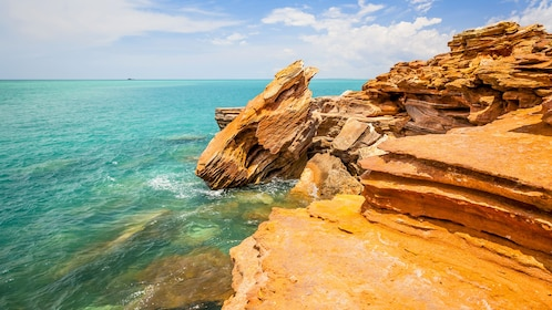 Turquoise water with orange rocky shore on Cape Leveque.