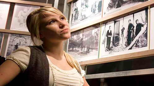 young woman looking at historical photos at Port Arthur in Hobart