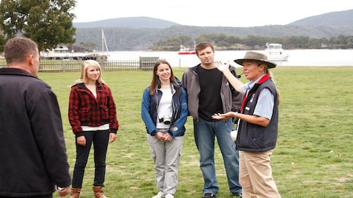 tour guide entertains visitors at Port Author in Hobart