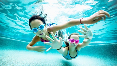 Two young girls swimming in the Keppel Bay in Australia.